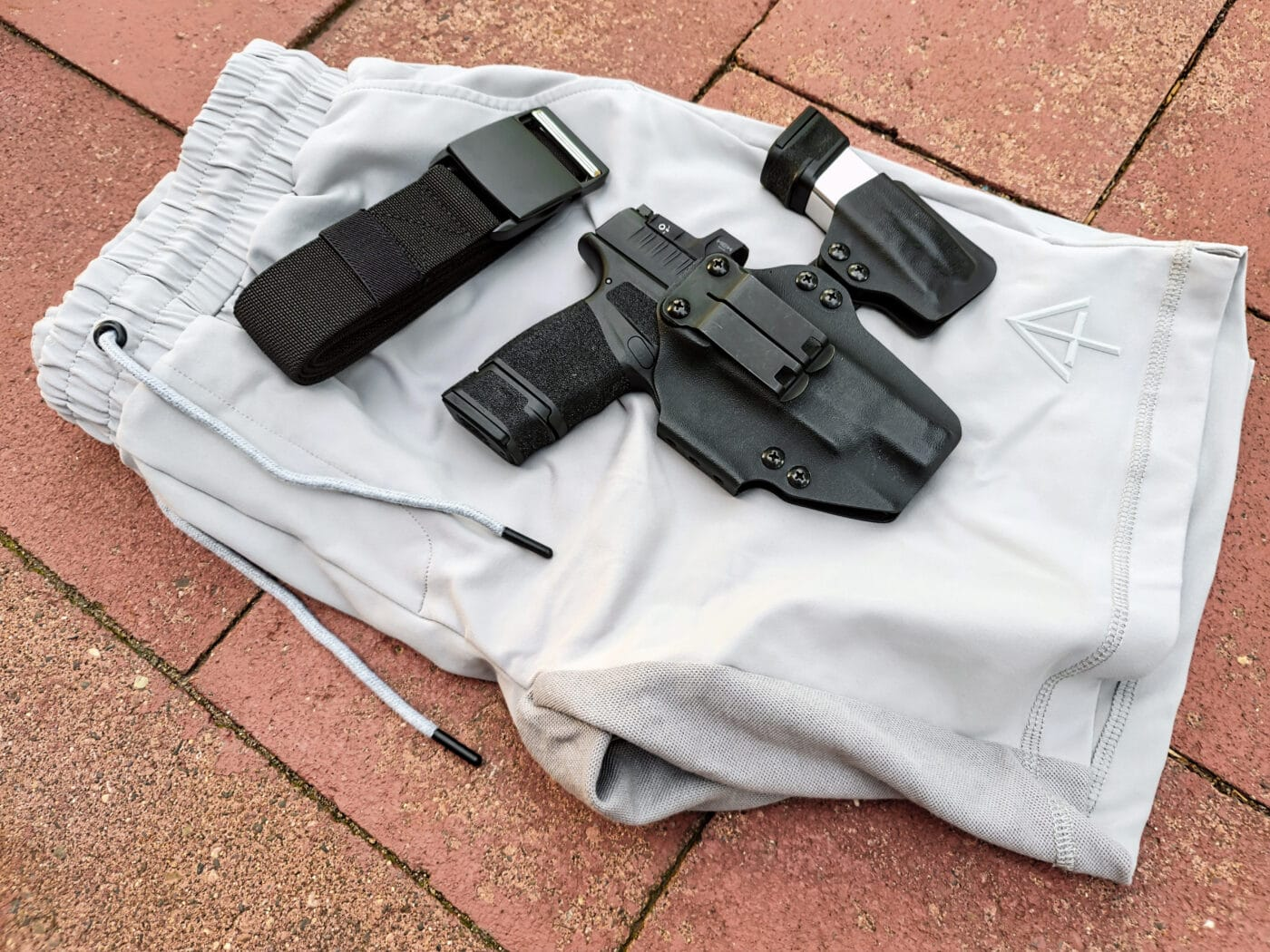 Pistol shown on top of concealed carry shorts