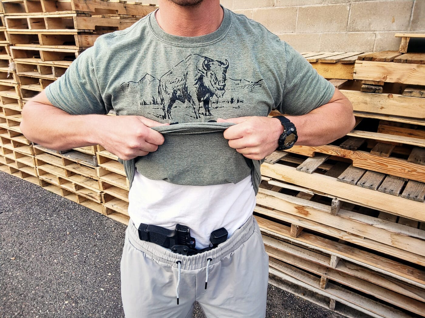 Man showing concealed carry athletic shorts