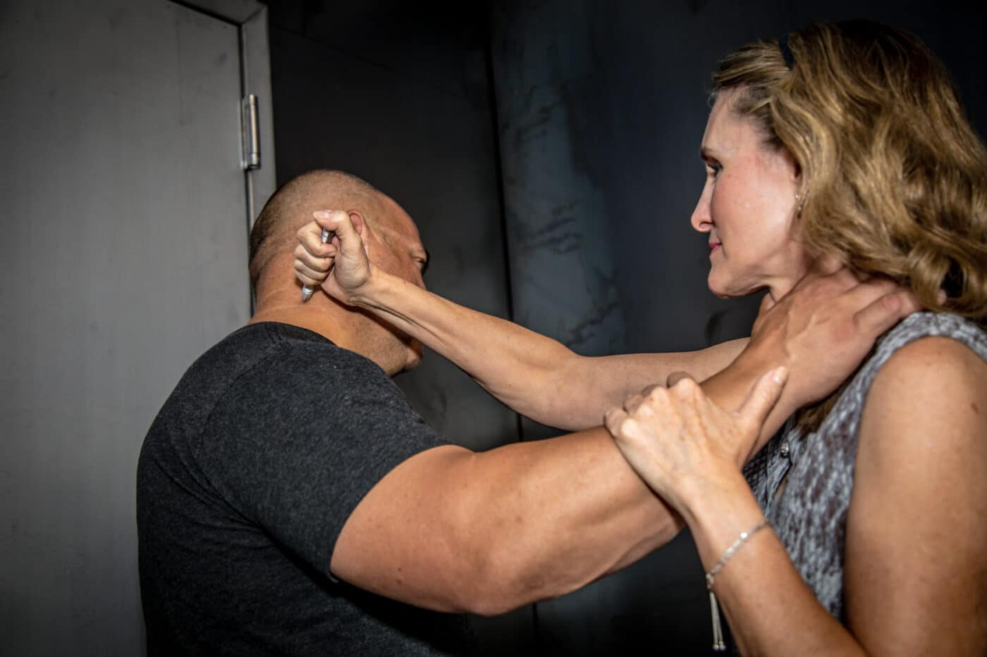 Woman stops choke with a neck stab