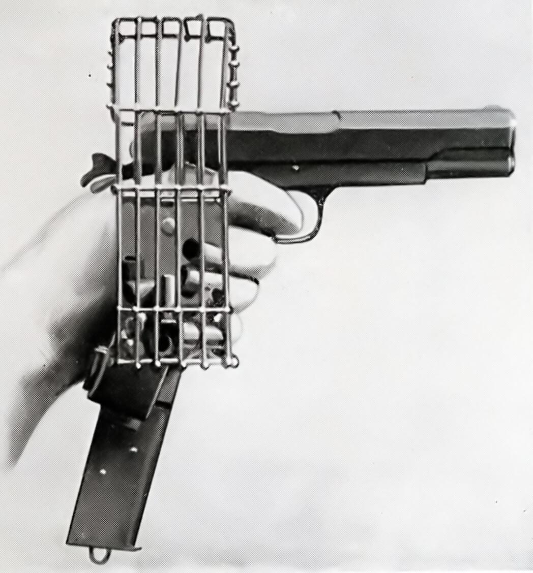 M1911 pistol with cartridge catcher