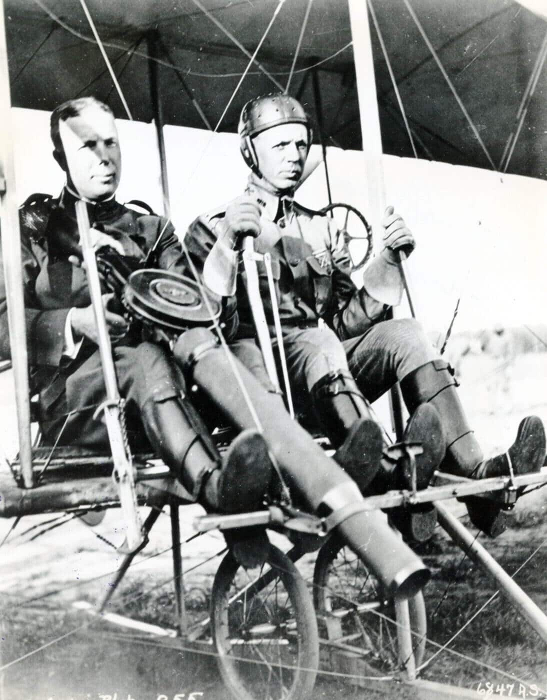 Lewis gun strapped onto a Wright Model B Flyer with two men in plane