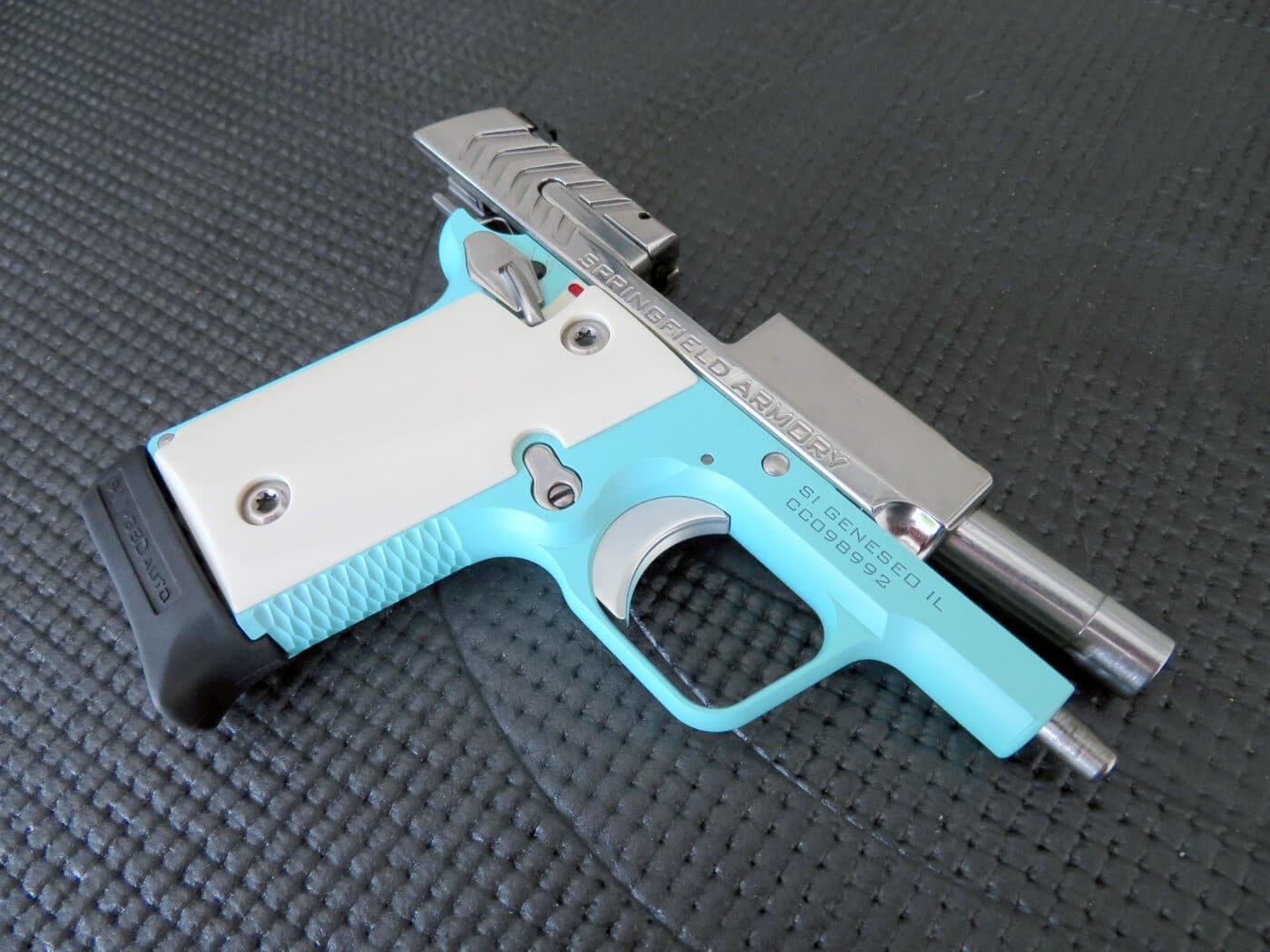 Right side view of the robin egg blue 911 pistol with slide locked back