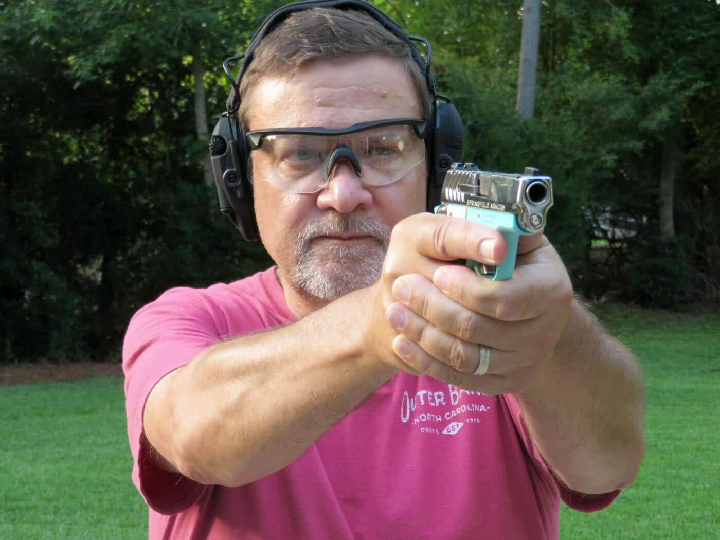 Man shooting a Vintage Blue 911 pistol