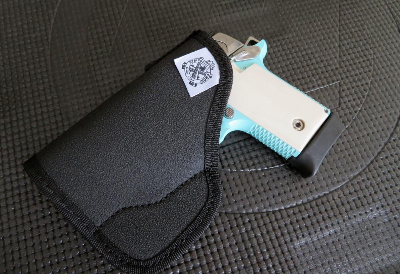 Vintage blue Springfield 911 in pocket holster