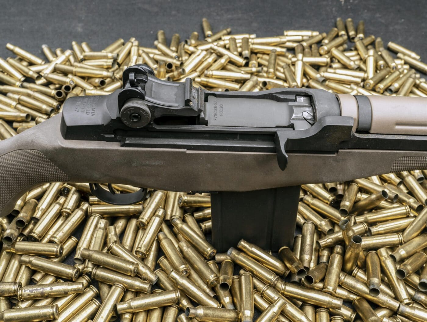 M1A with the bolt closed on top of a bunch of spent cases