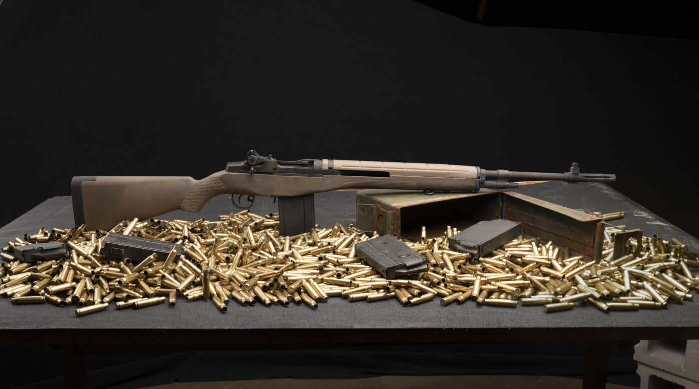 M1A rifle surrounded by ammo on a table