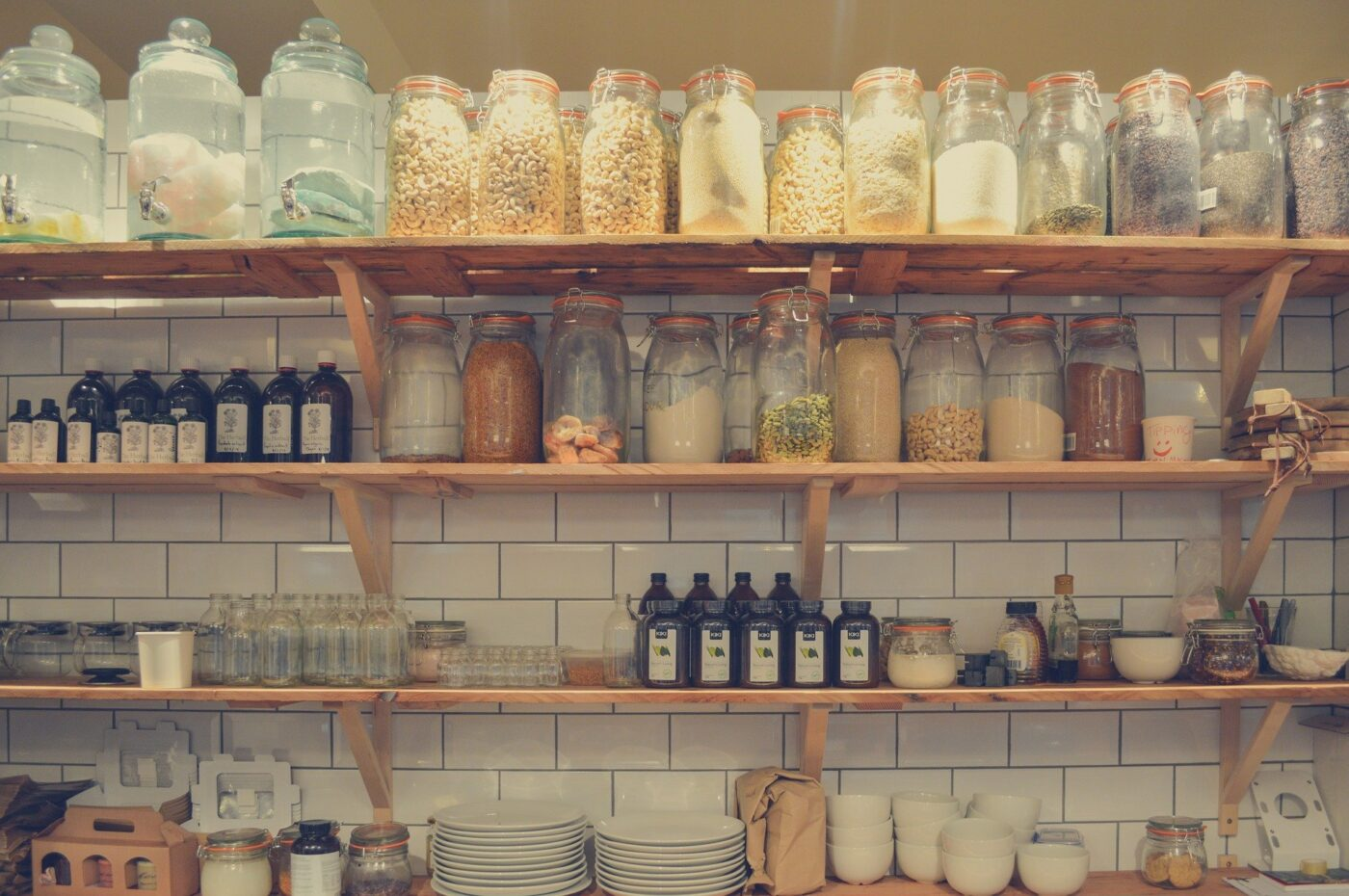 Canned goods on shelves in a kitchen