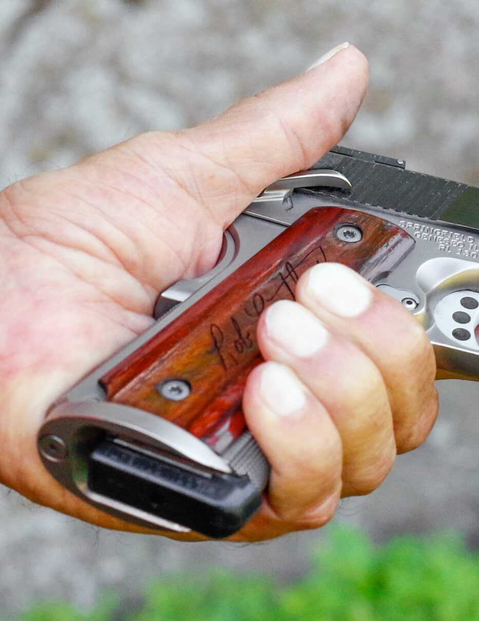 Grasp 1911 to engage safety