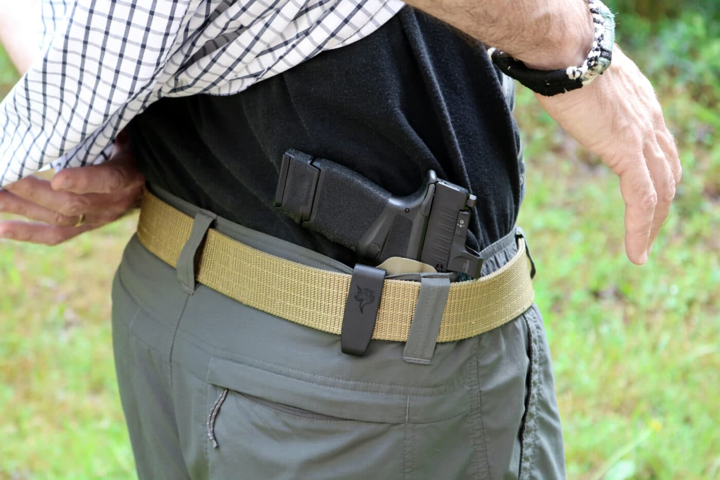 Man showing EDC holster by DeSantis  for Springfield Hellcat