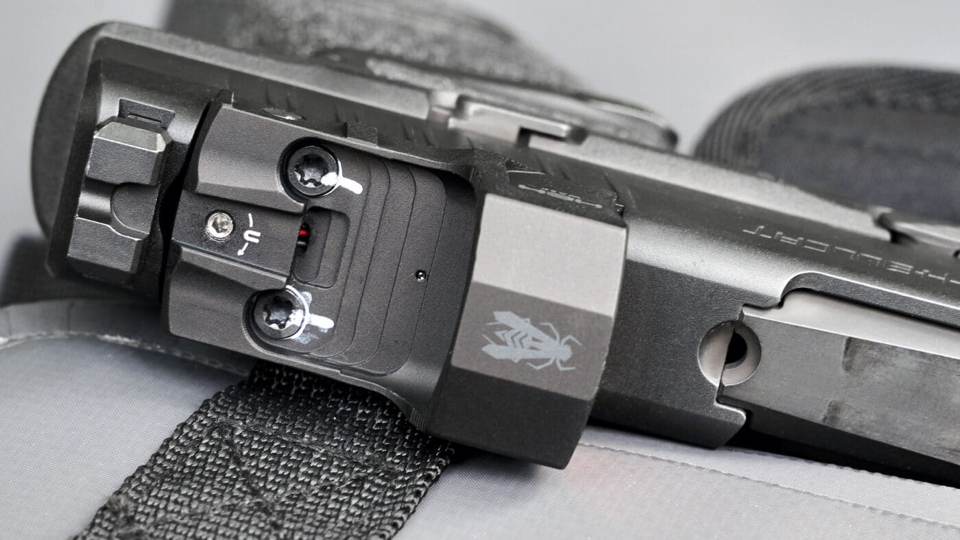 HEX Wasp red dot mounted to Hellcat pistol with white paint to see if screws loosen over time