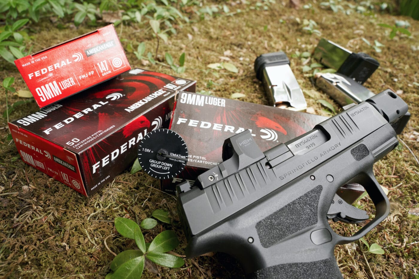 HEX Wasp optic with the Springfield Hellcat RDP and boxes of ammo