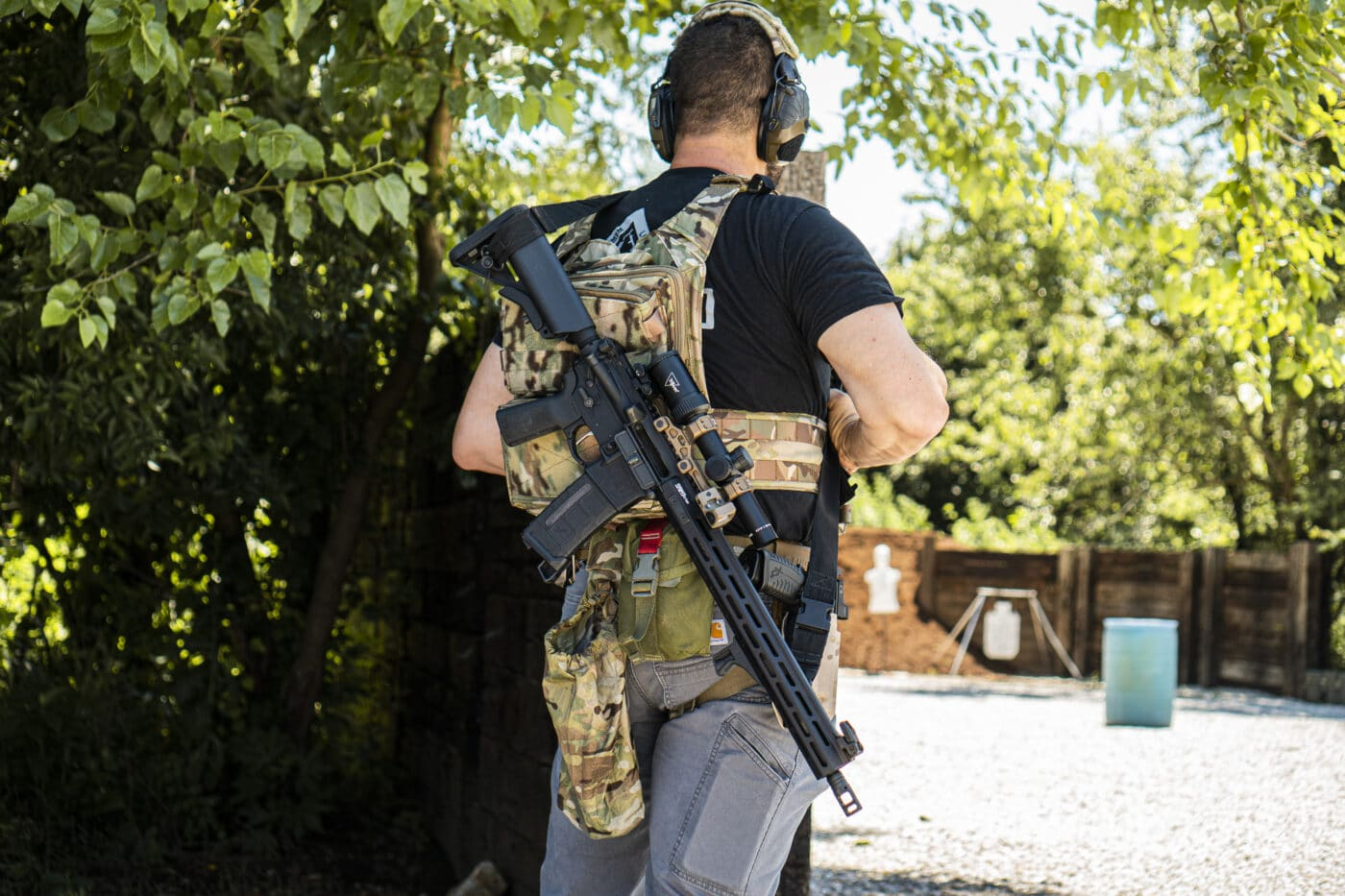 Man carrying rifle with a two-point rifle sling