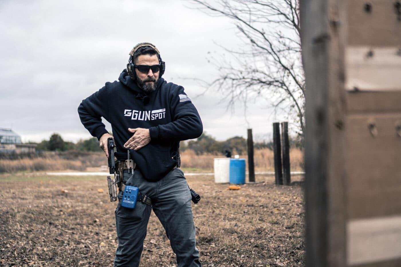 Man drawing pistol during combat marksmanship training