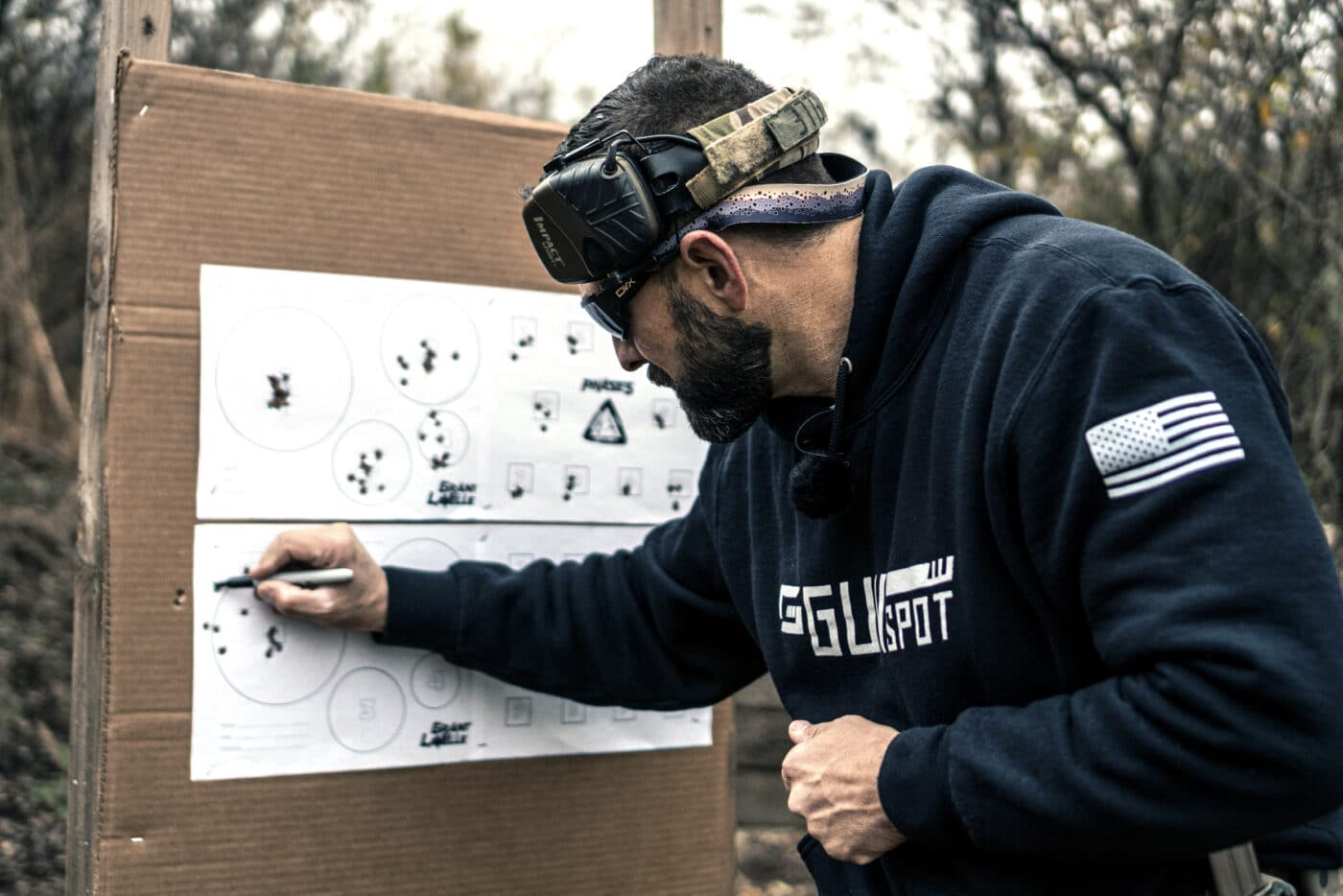 Man looking at target for Phase 5 shooting drill