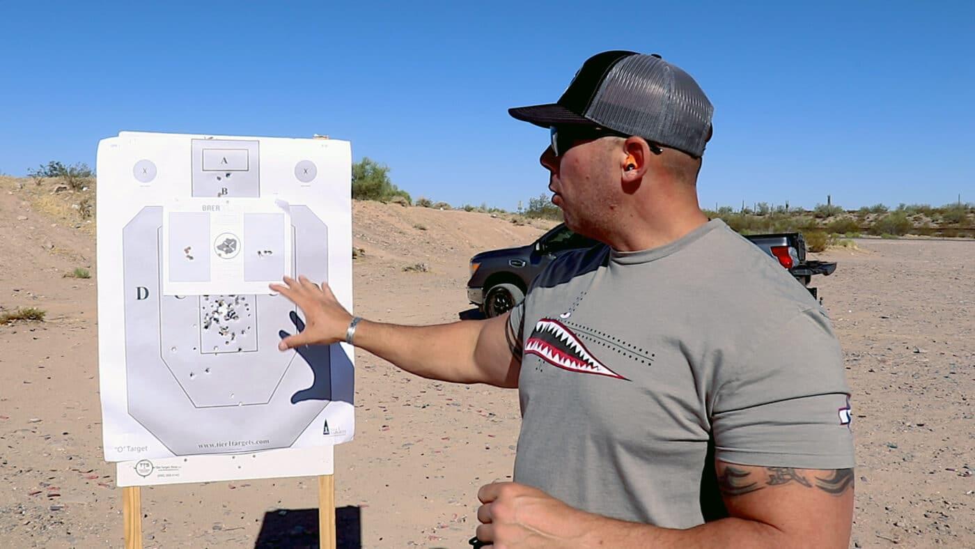 Man analyzing Baer Drill target