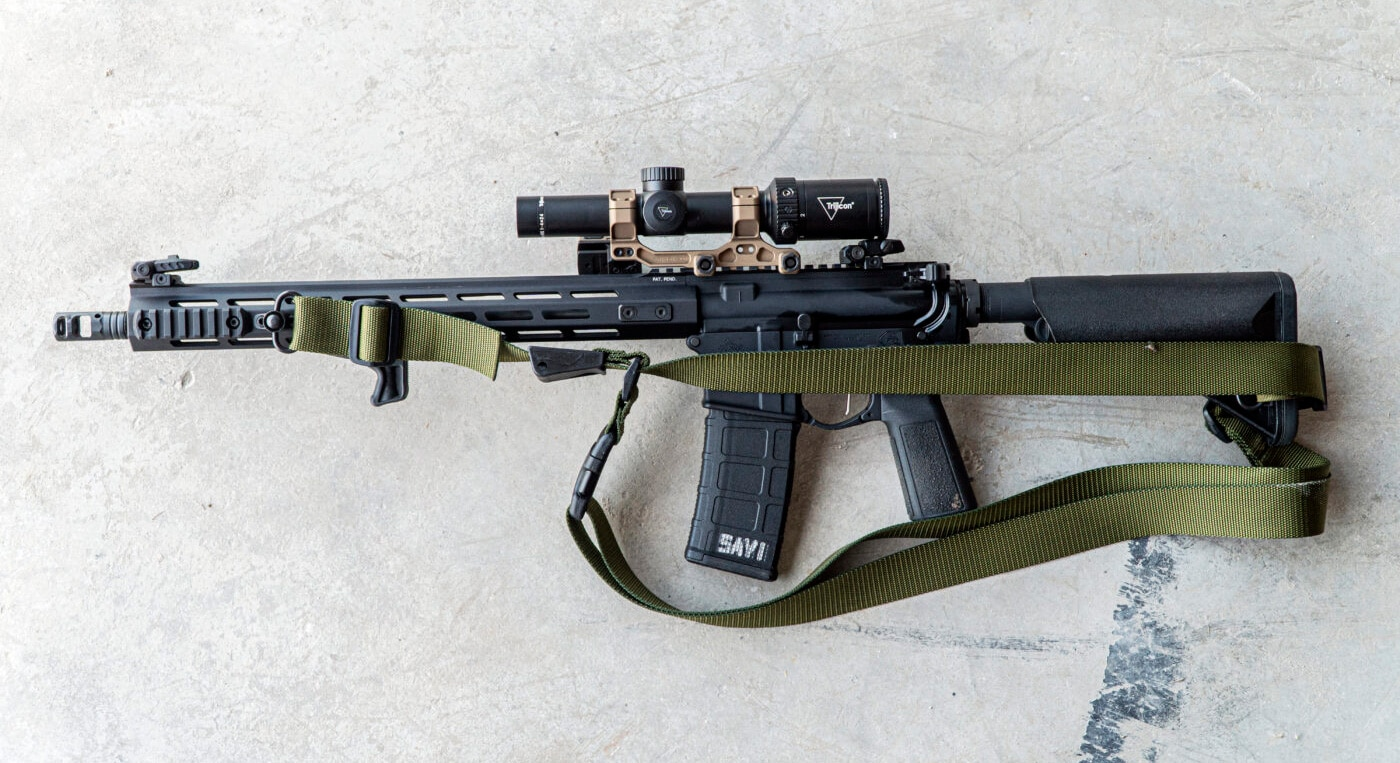 Three-point sling attached to a rifle