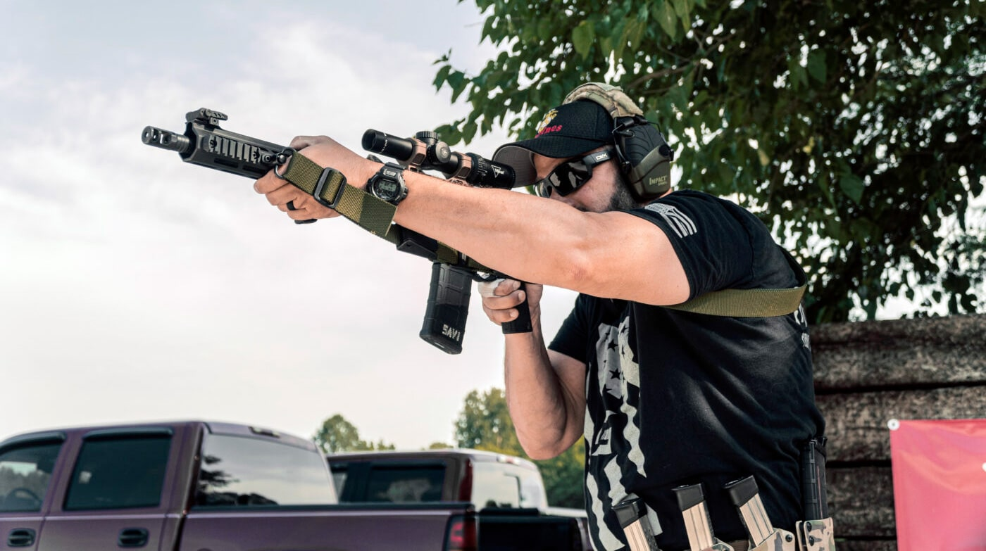 Man using rifle with three-point sling