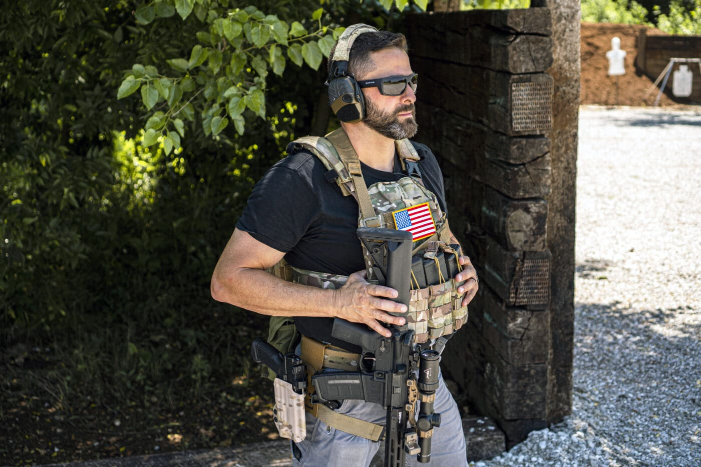 Man with a single point sling attached to an AR-15