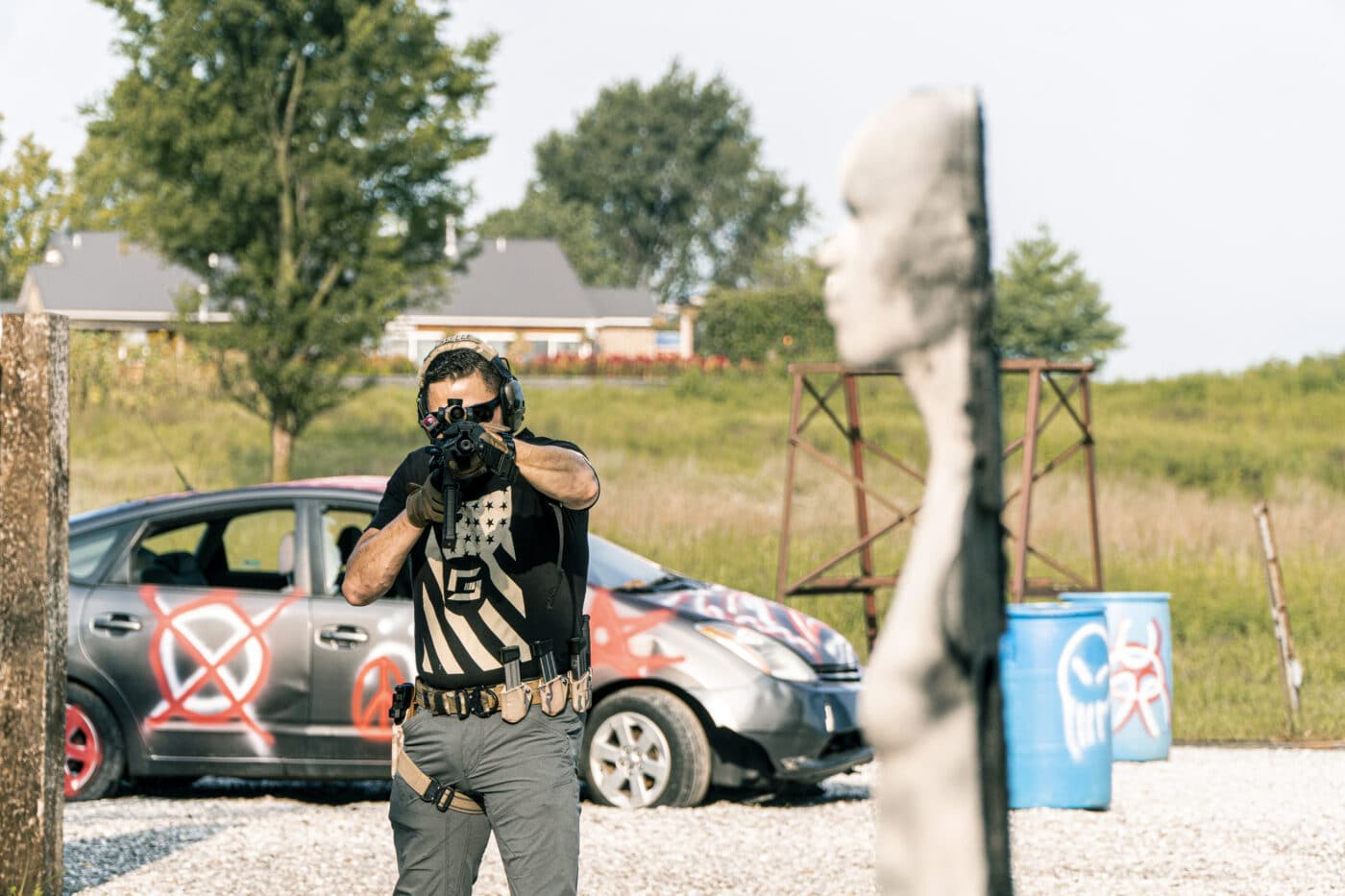 Man training with Rubber Dummies target