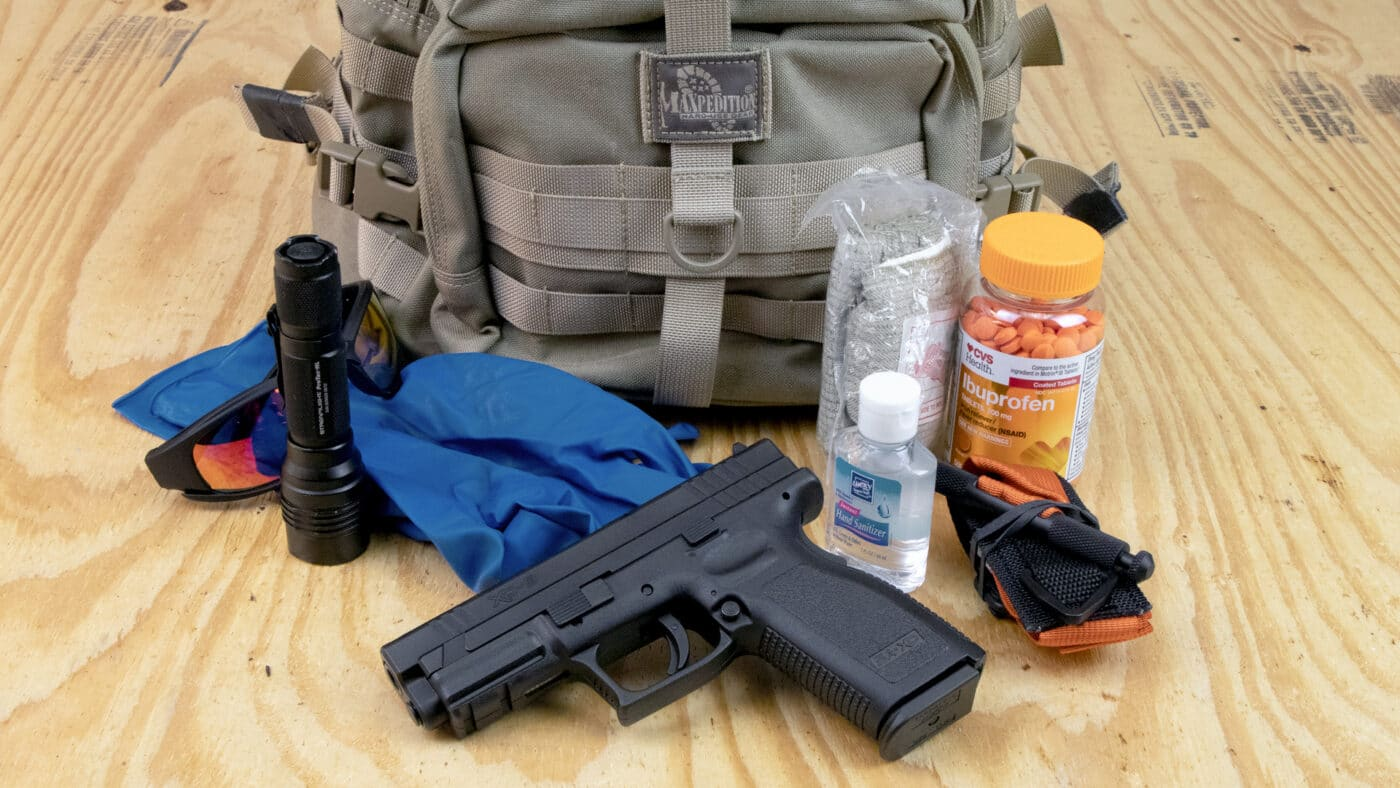 Get home bag with some of its contents shown alongside