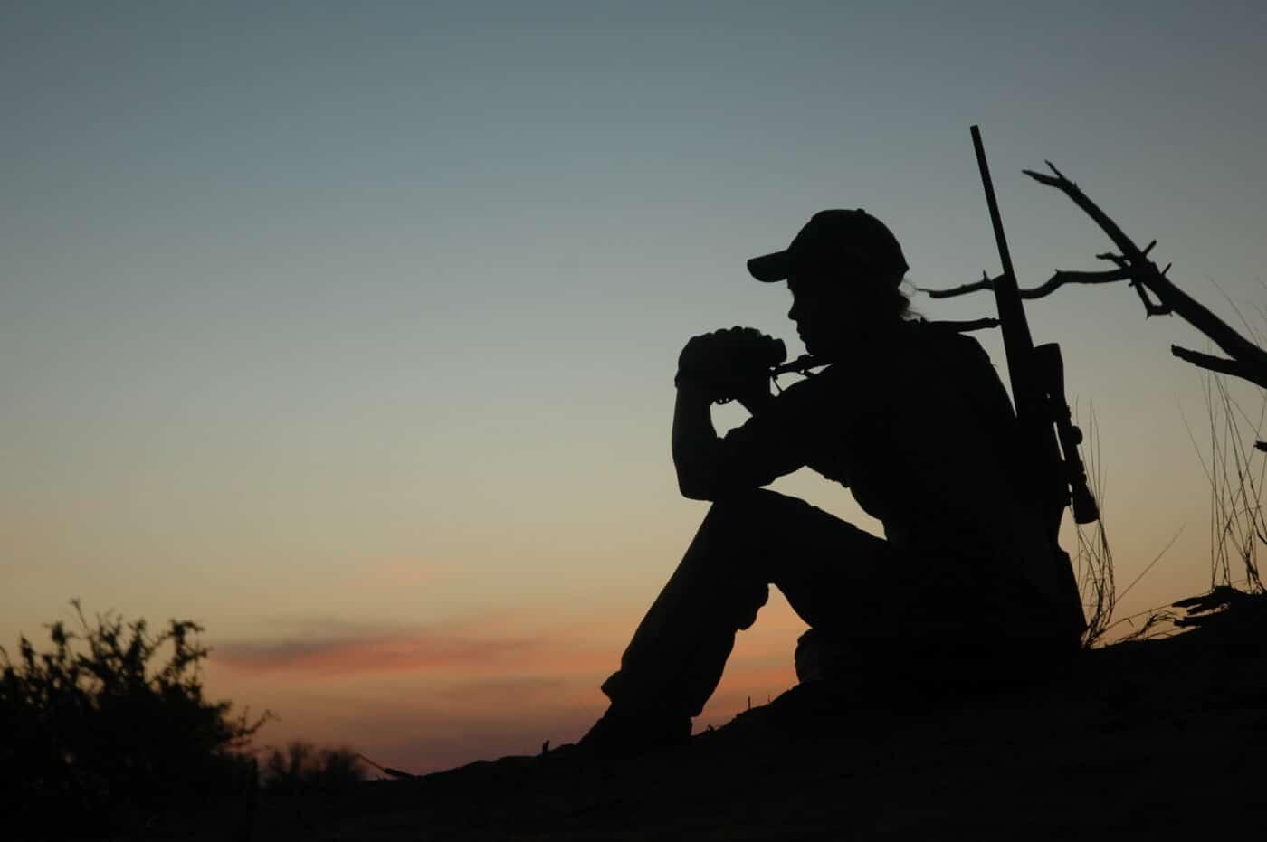 Image of woman hunting at dusk