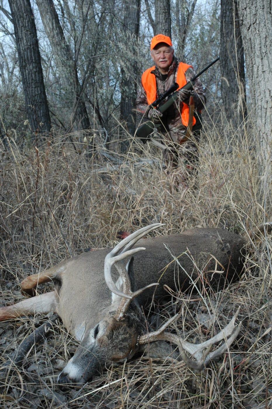 Man with buck taken a close range during deer hunting season