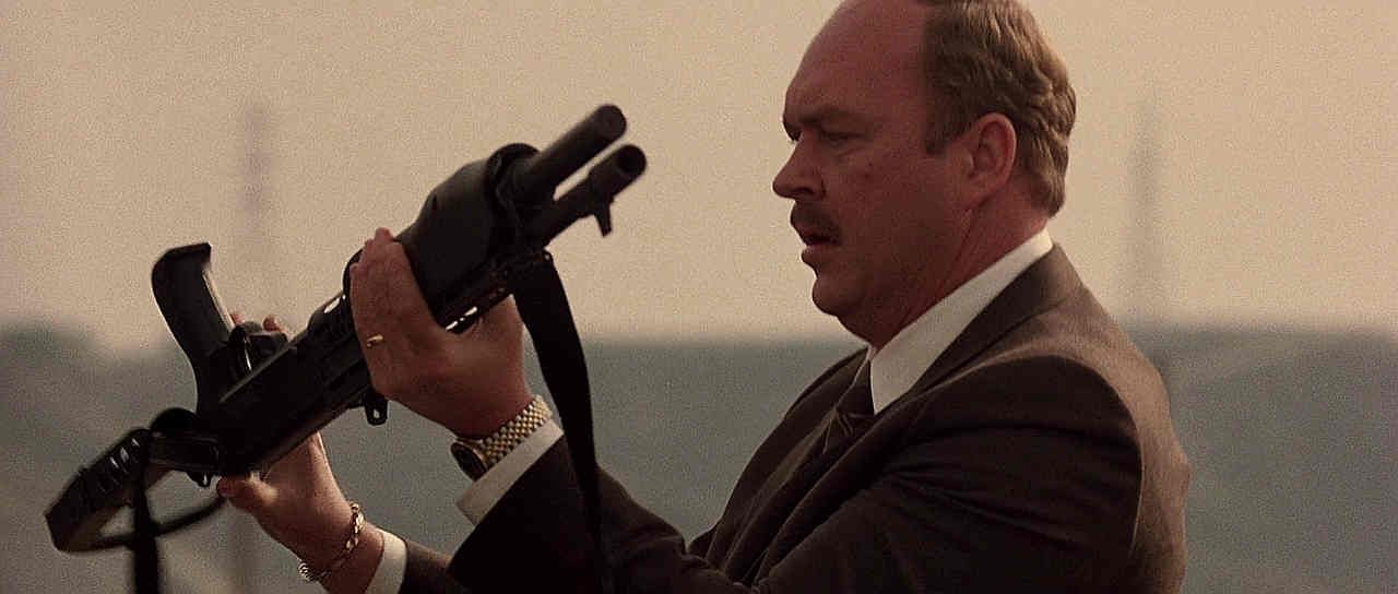 Detective Taggart examines a SPAS-12 in Beverly Hills Cop II