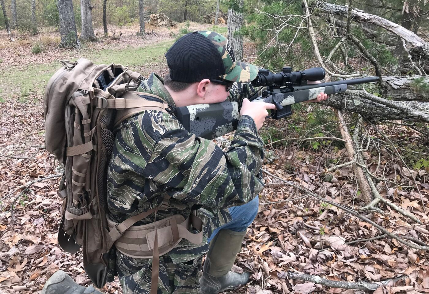 Man using Gunslinger II backpack on a hunt