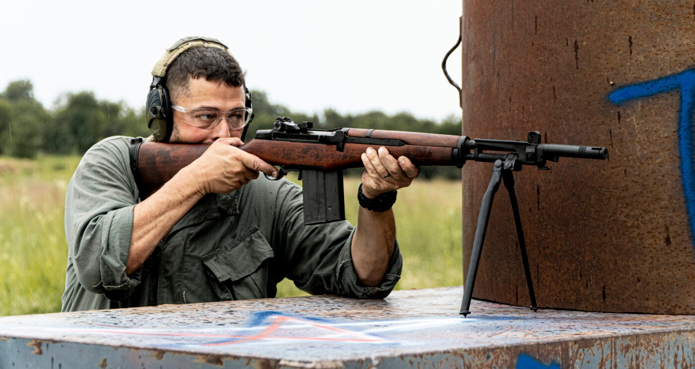 Man shooting rifle with 7.62x51 NATO round at 750 rounds per minute