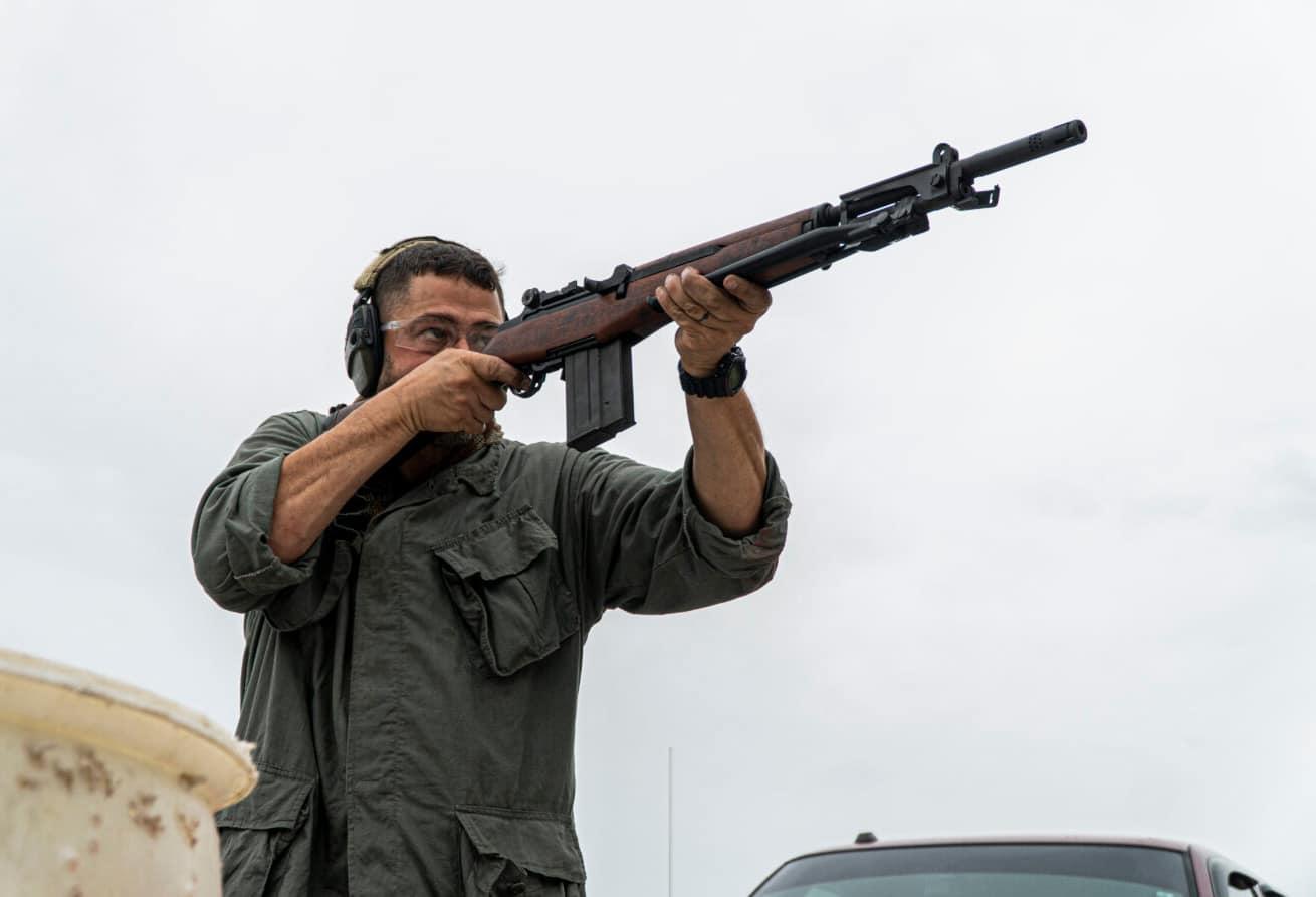 Man shooting a BM 59, an Italian version of a modernized M1 Garand