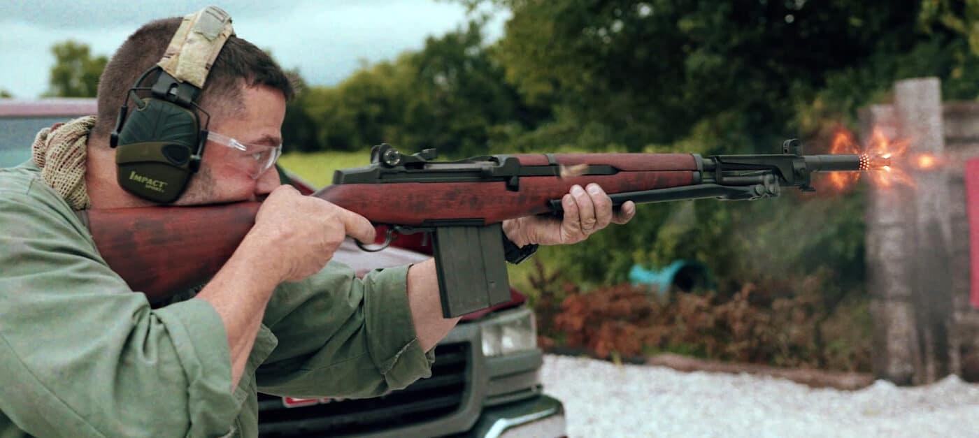 Man shooting battle rifle in .308