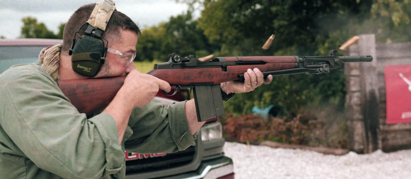 Man shooting rifle full auto burst