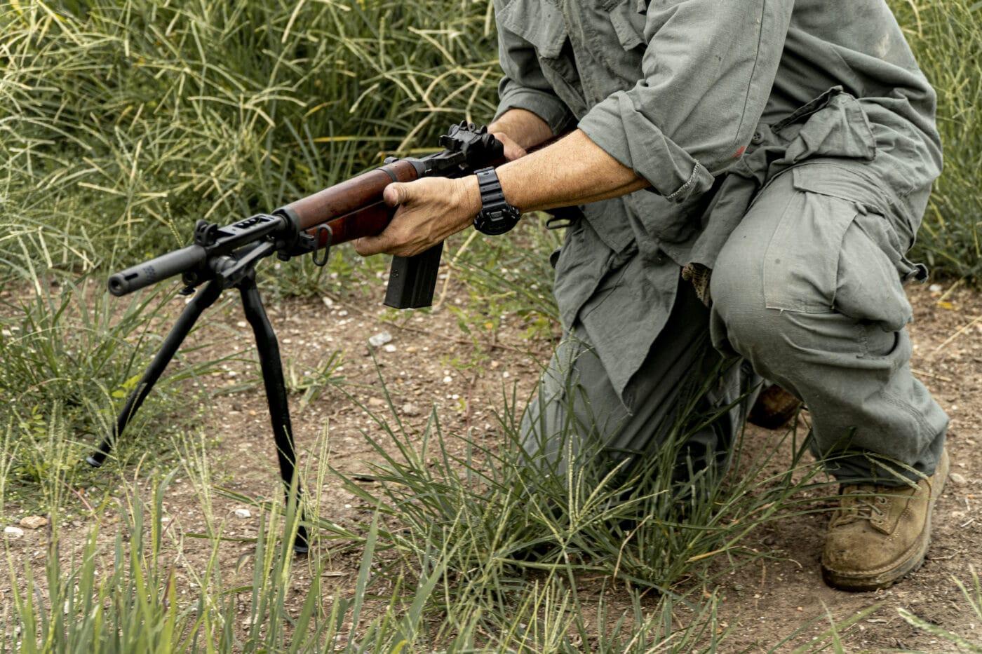 Man carrying an Italian battle rifle