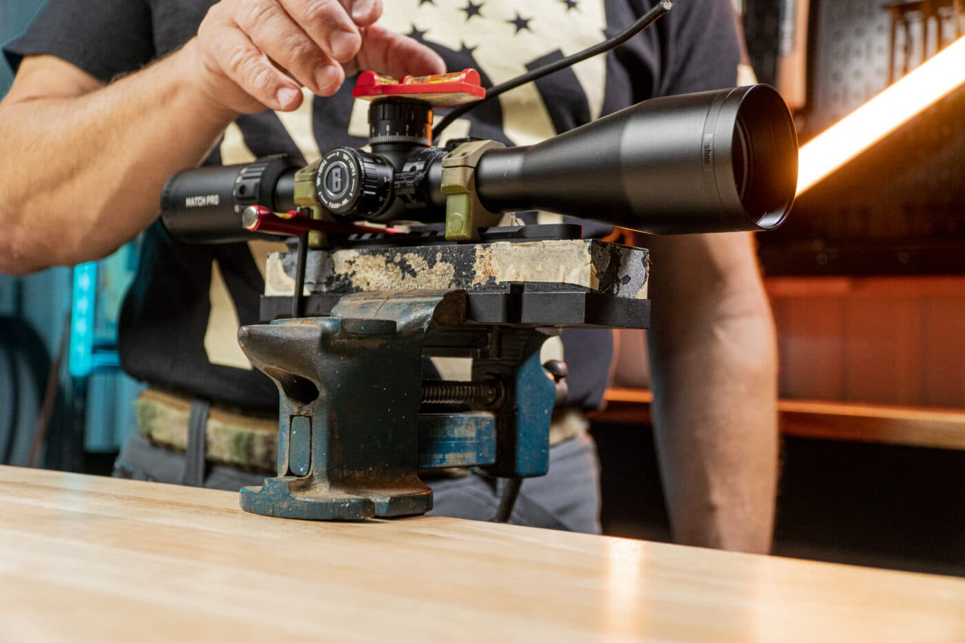 Man starting the scope mounting process using a level