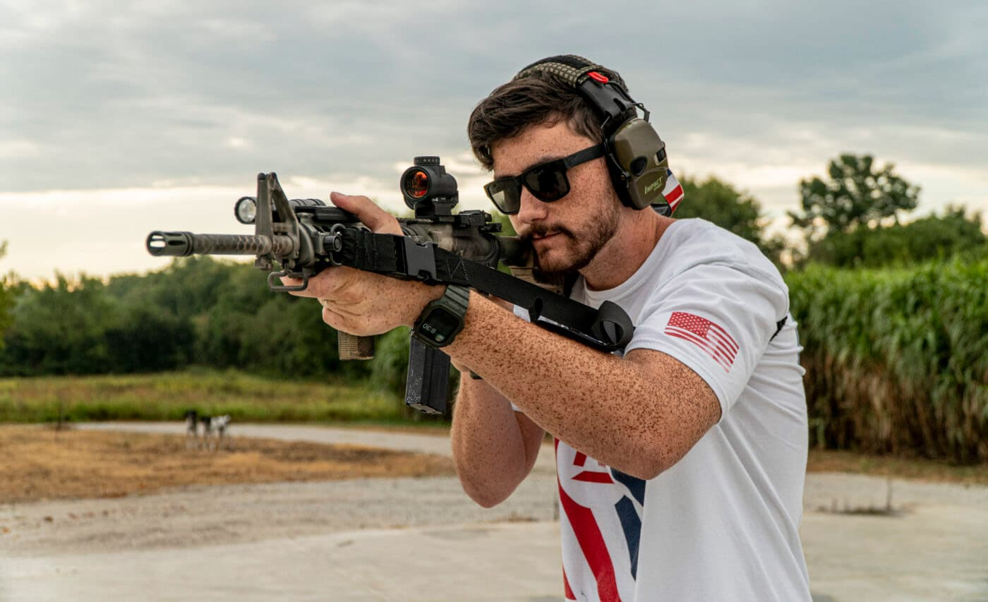 Man demonstrating how to shoot with a two-point sling