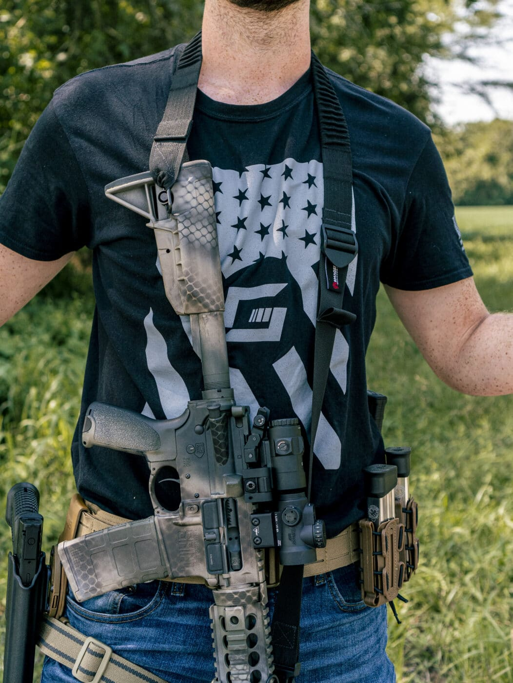 Man showing security of rifle with a sling