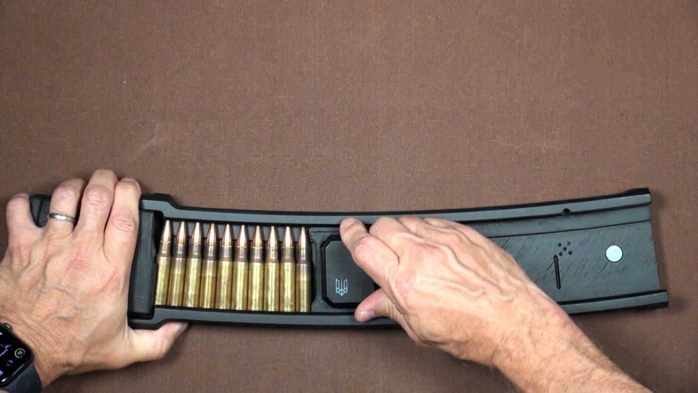 Podavach U-Loader loading ammo into magazine