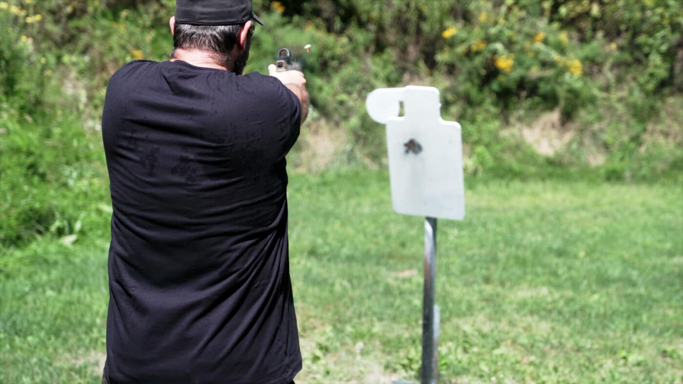 Man shooting steel targets with Norma frangible ammo
