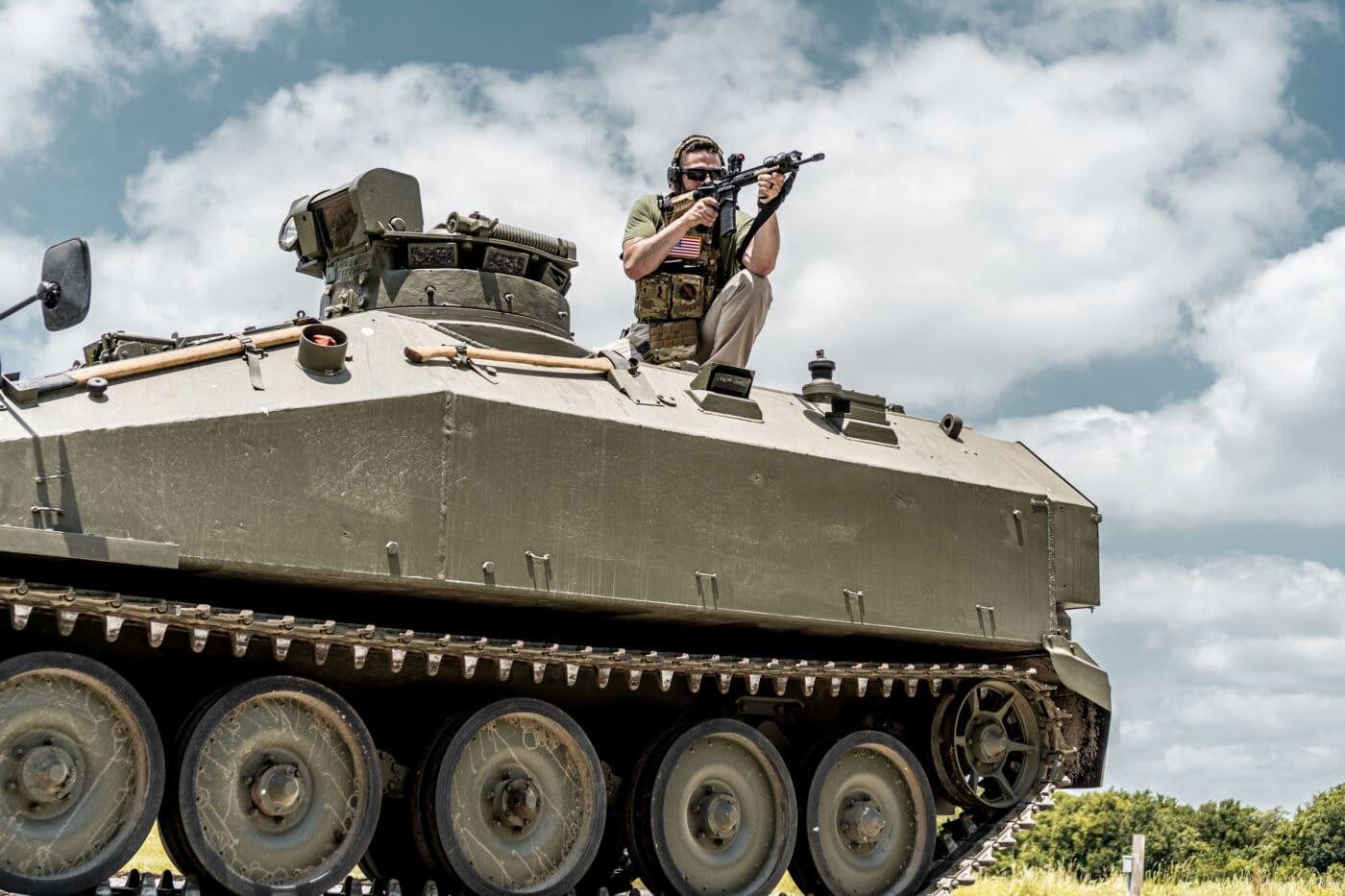 Man testing the HRT body armor from an APC