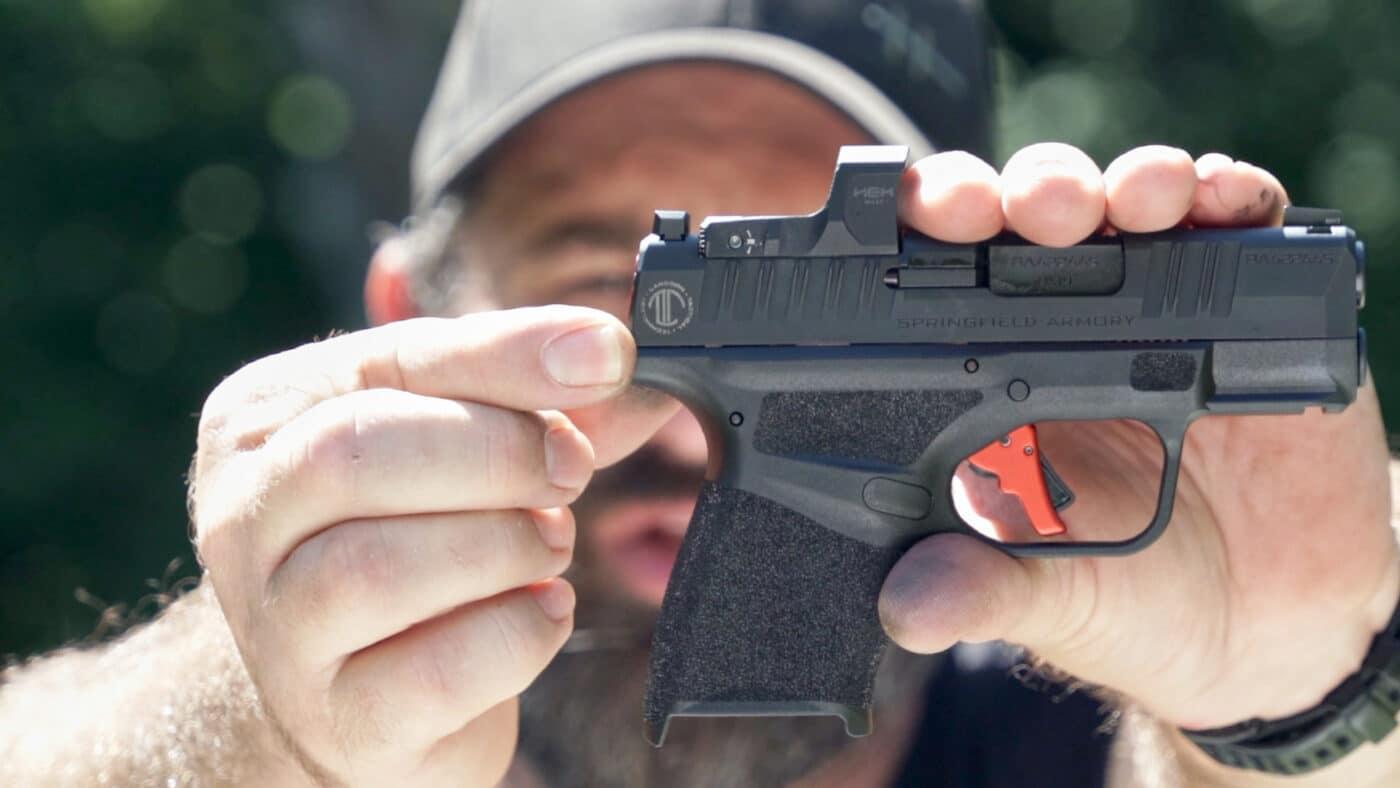 Man holding LTT Custom Hellcat pistol