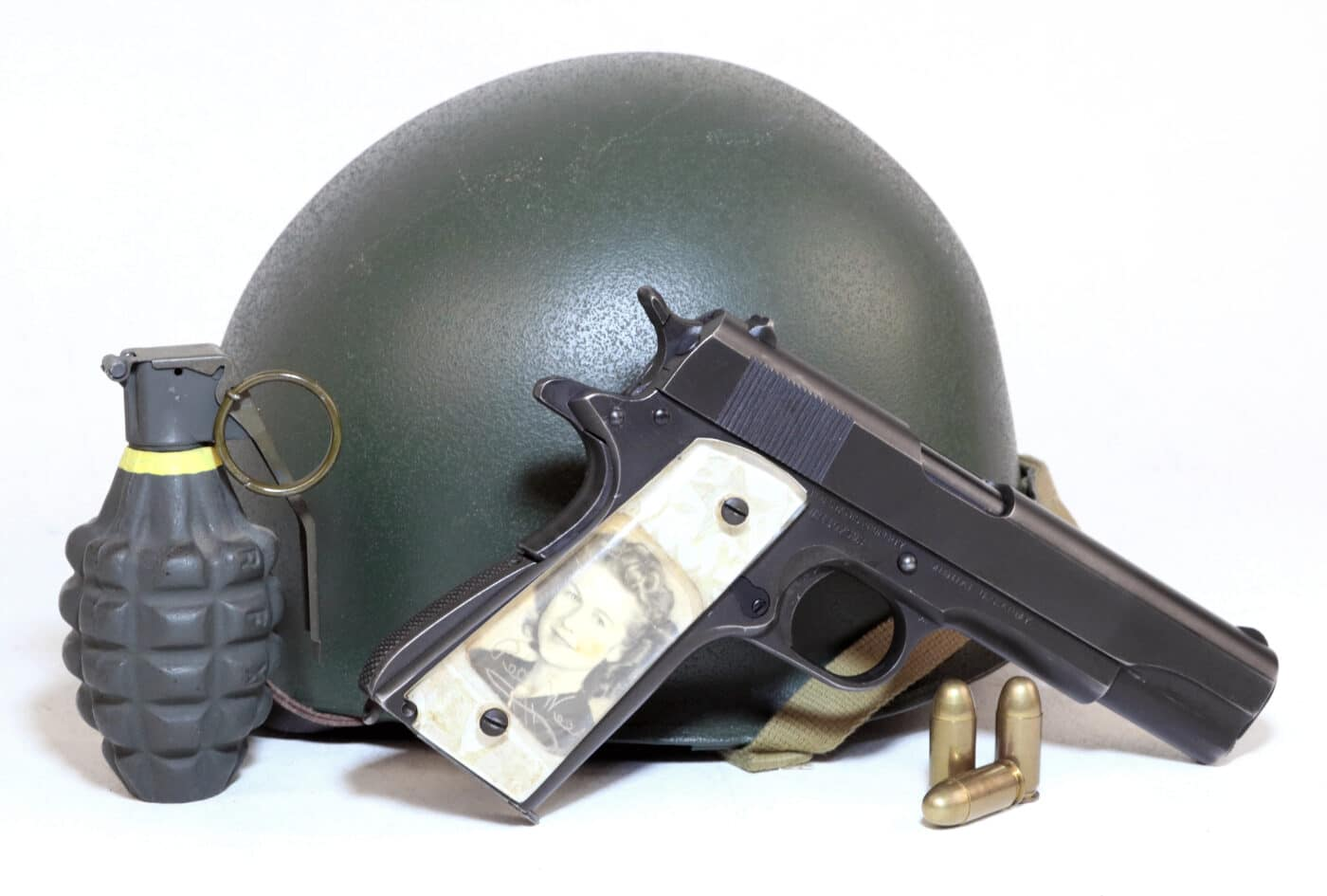 Vintage WWII sweetheart grips on 1911 with grenade, helmet, and ammo