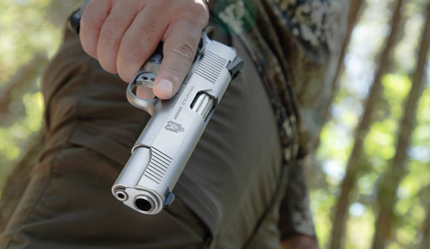 Man holding Springfield Armory stainless steel TRP 1911
