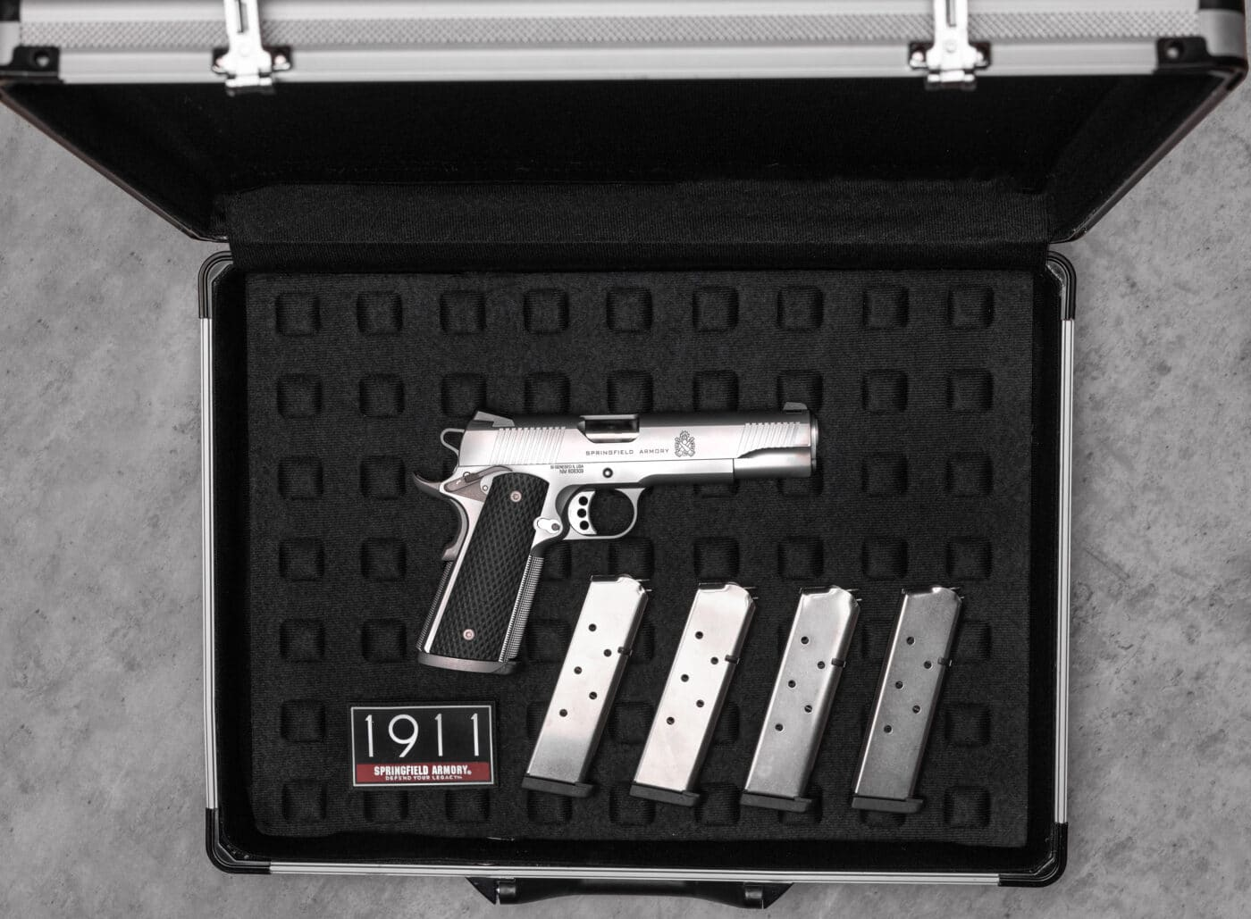 Stainless steel 1911 TRP from Springfield in a case with magazines