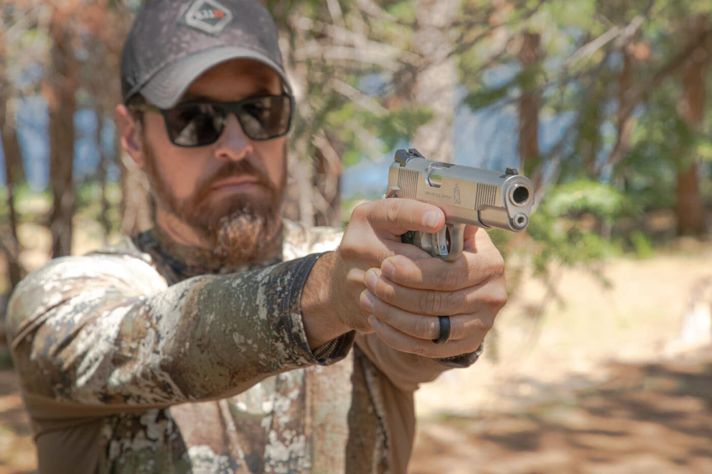 Man shooting the stainless steel Springfield TRP