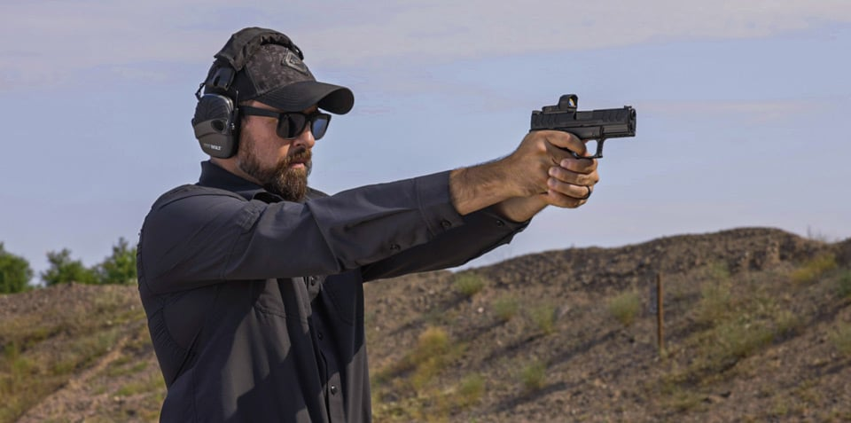 Man testing the XD-M Elite 10mm Compact OSP at the range
