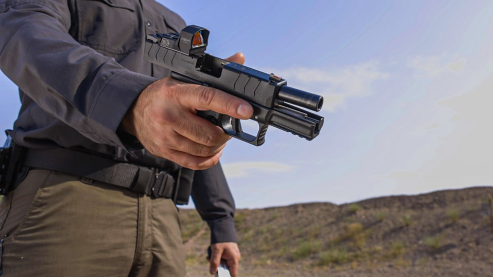 Man demonstrating a one handed grip on the XD-M Elite Compact OSP pistol