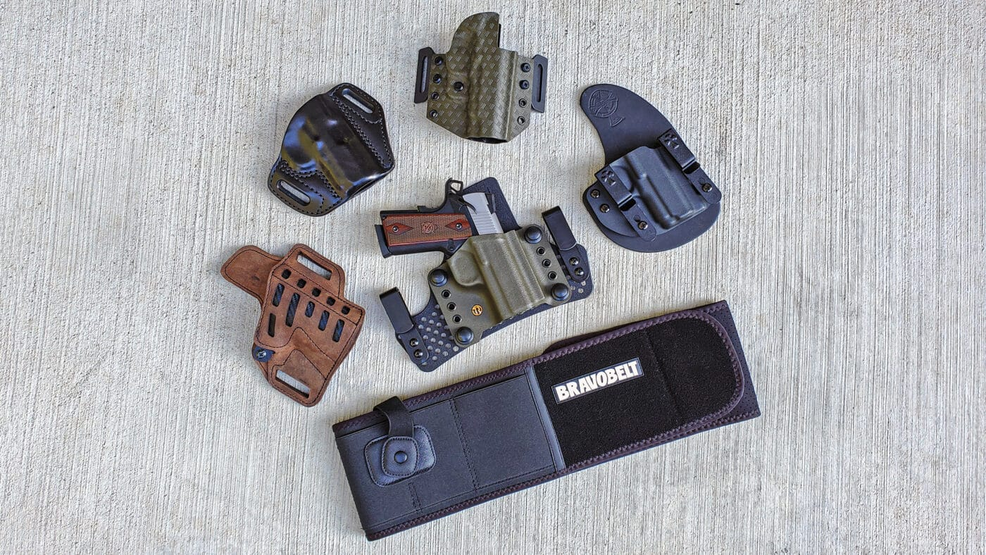 Various holsters for a Springfield Armory EMP 1911 pistol