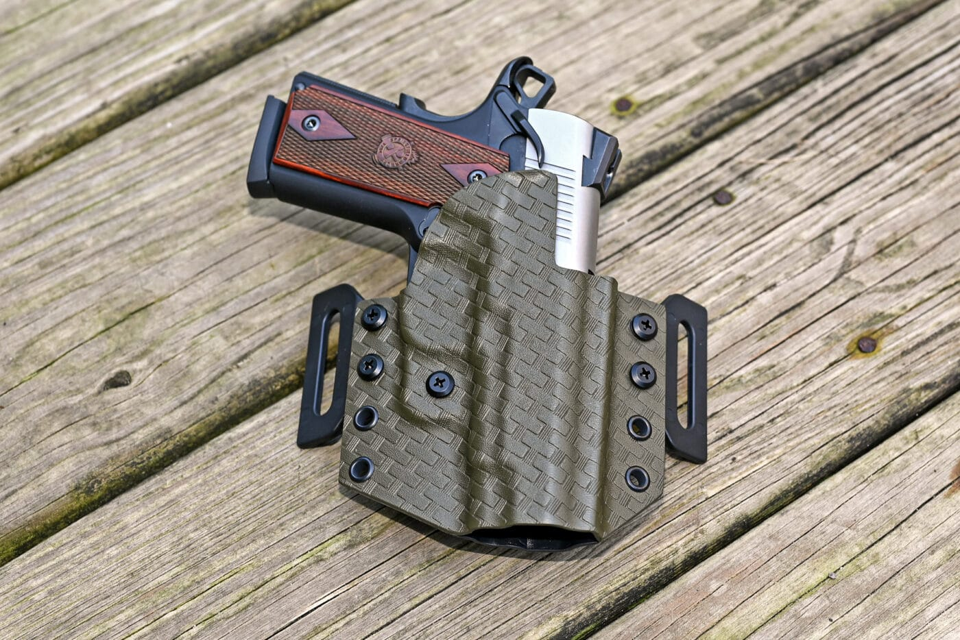 Upper Hand CCW holster with EMP pistol in it