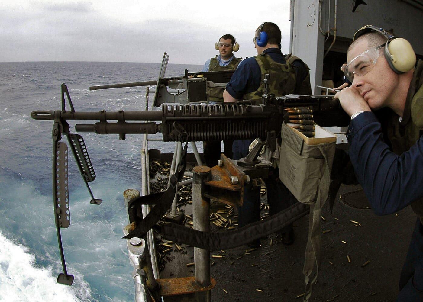 U.S. Navy sailors firing the M60 machine gun during ship exercises