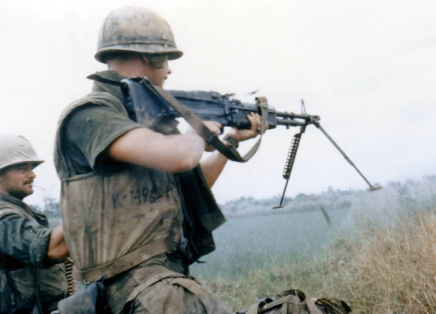 U.S. Marine fires the M60 machine gun from the shoulder in Vietnam